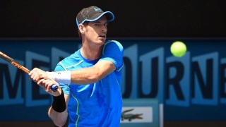Andy Murray moves safely into second round