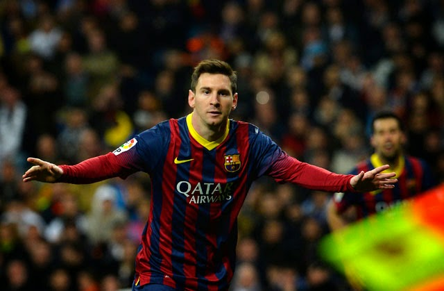 Messi hat-trick keeps Barcelona in sight of Real Madrid